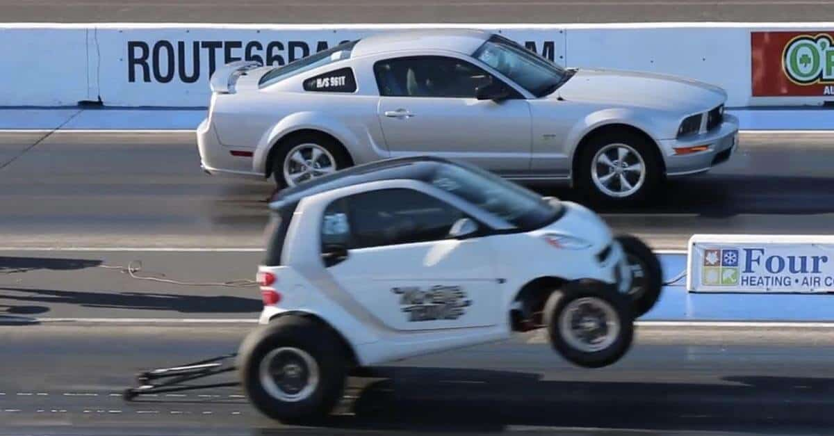 Customized Mustang >> Smart Car Races A Mustang GT And This Happened - Yeah! Motor