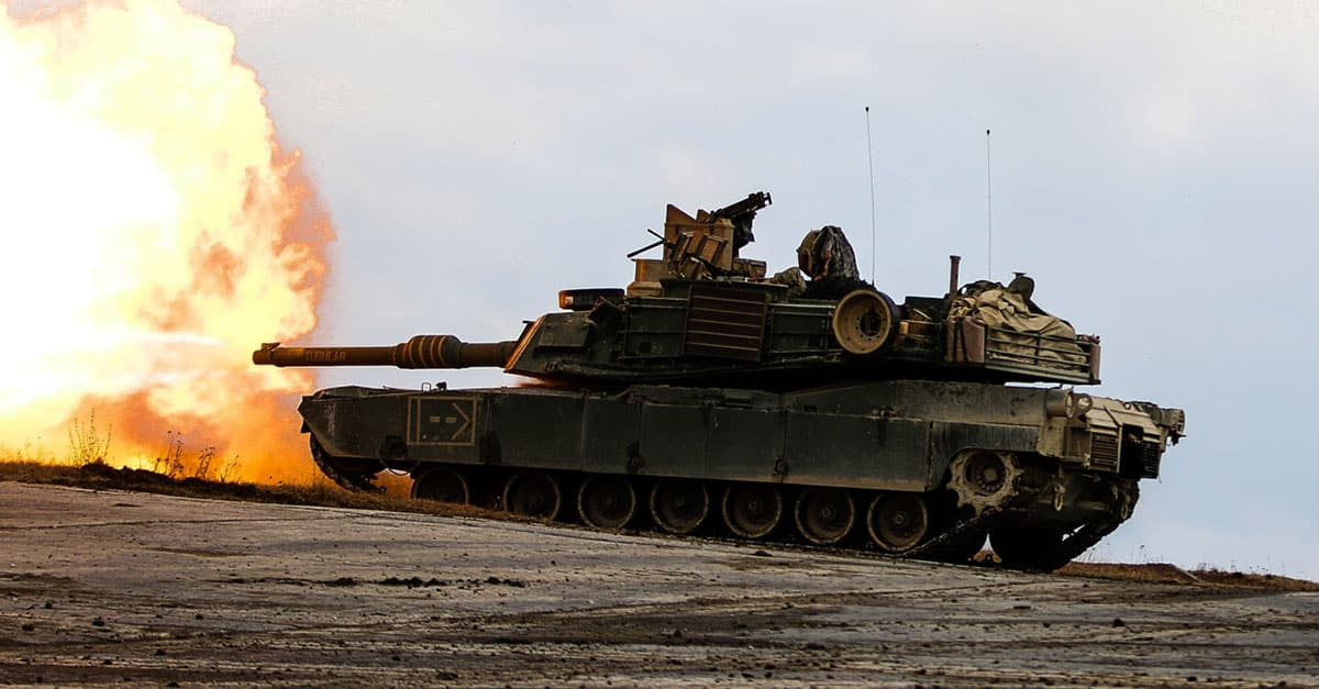 M1 Abrams- tank fires a round during a combined arms live fire exercise