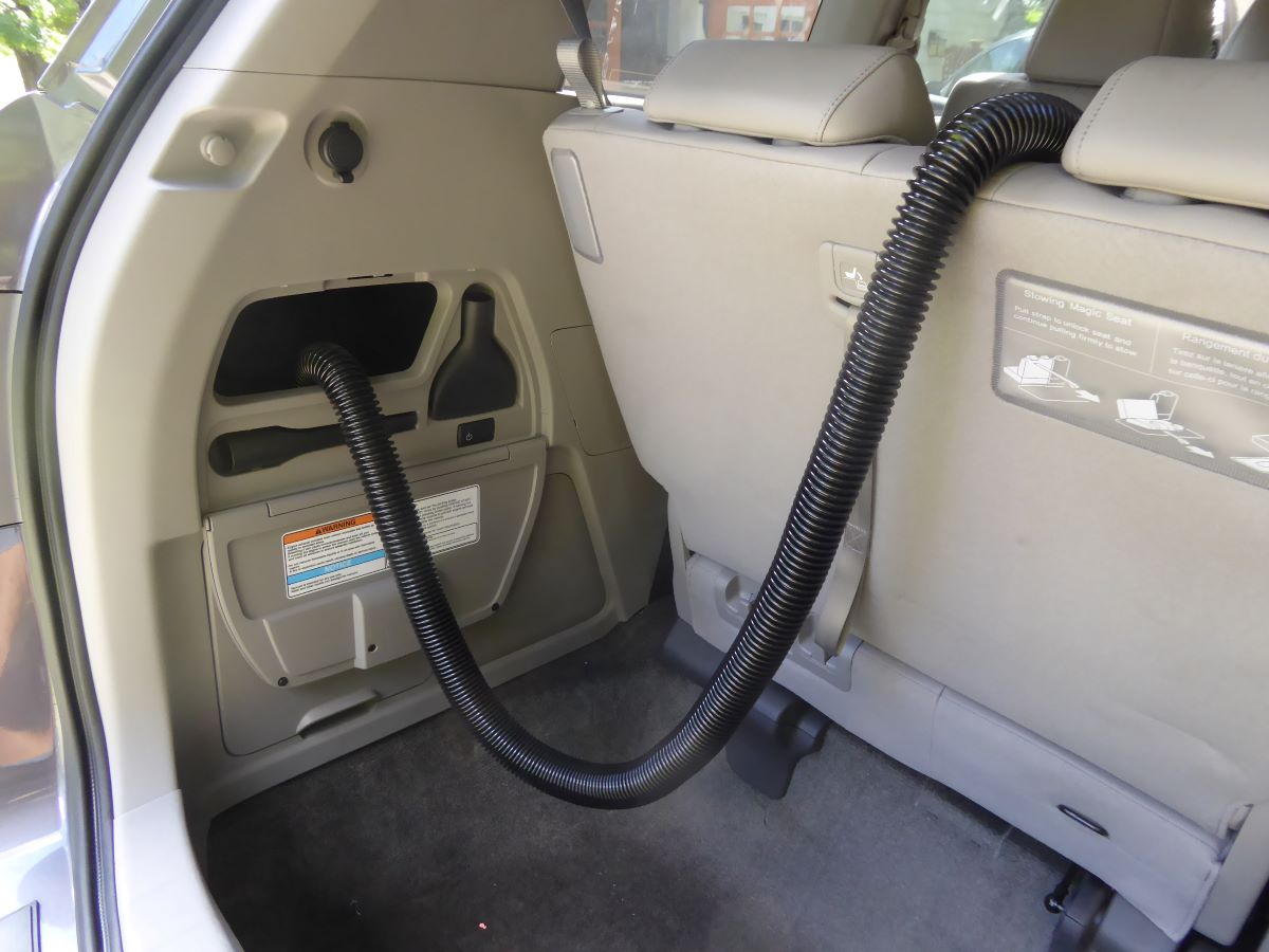 The built-in vacuum can reach any spot in the car
